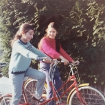 Cycling with my sister (red jumper) aged 10